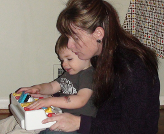 Mom and child playing with pop-up toy